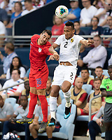 KANSAS CITY, KS - JUNE 26: Daniel Lovitz #16 and Francisco Palacios #2 go up for a header during a game between United States and Panama at Children's Mercy Park on June 26, 2019 in Kansas City, Kansas.