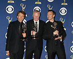 LOS ANGELES, CA. - September 20: Producers of 'The Amazing Race' Jerry Bruckheimer, Bert Van Munster and Phil Keoghan  pose in the press room at the 61st Primetime Emmy Awards held at the Nokia Theatre on September 20, 2009 in Los Angeles, California.