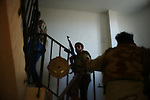 Sirte, LIBYA: Monday 11th October 2011:..Rebel fighters search a house in the city of Sirte for loyalist forces. ..Ayman Oghanna