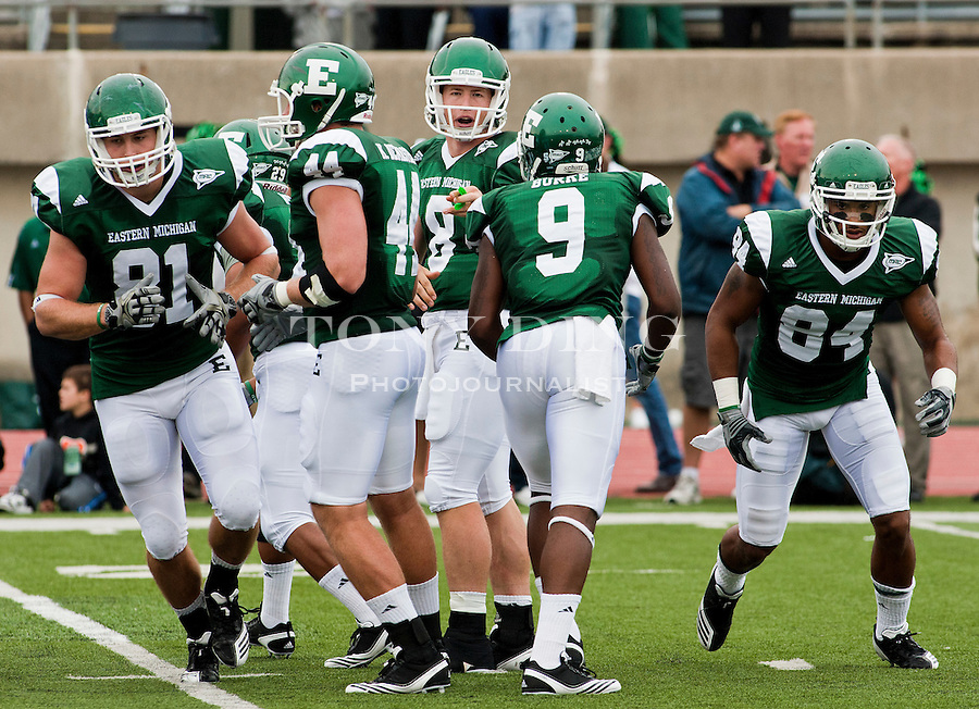 Eastern Michigan quarterback Alex Gillett (8) directs his offense before a snap in the first quarter of an NCAA college football game with Central Michigan, Saturday, Sept. 18, 2010, in Ypsilanti, Mich. (AP Photo/Tony Ding)