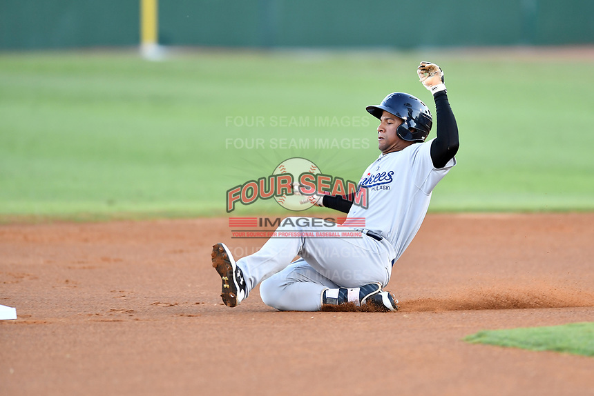 Pulaski Yankees right fielder Frederick Cuevas (27) slides into second base during game one of the Appalachian League Championship Series against the Elizabethton Twins at Joe O'Brien Field on September 7, 2017 in Elizabethton, Tennessee. The Twins defeated the Yankees 12-1. (Tony Farlow/Four Seam Images)