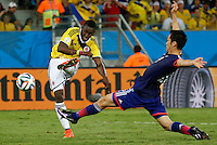 CUIABA - BRASIL -24-06-2014. Foto: Roberto Candia / Archivolatino<br /> Jackson Martinez (#21) jugador de Colombia (COL) dispara para anotar gol a Japón (JPN) sobre el jugador Maya Yoshida (#23) durante partido del Grupo C de la Copa Mundial de la FIFA Brasil 2014 jugado en el estadio Arena Pantanal de Cuiaba./ Jackson Martinez (#21) player of Colombia (COL) shoot to scored a goal to Japan (JPN) over the player Maya Yoshida (#23) during the match of the Group C of the 2014 FIFA World Cup Brazil played at Arena Pantanal stadium in Cuiaba. Photo: Roberto Candia / Archivolatino<br /> VizzorImage PROVIDES THE ACCESS TO THIS PHOTOGRAPH ONLY AS A PRESS AND EDITORIAL SERVICE IN COLOMBIA AND NOT IS THE OWNER OF COPYRIGHT; ANOTHER USE IS REPONSABILITY OF THE END USER. NO SALES, NO MERCHANDASING. ALL COPYRIGHT IS ARCHIVOLATINO