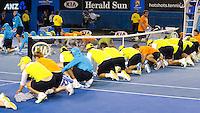 AMBIENCE, Ball Kids and Court cleaners dry the court during NOVAK DJOKOVIC (SRB) against RAFAEL NADAL (ESP) in the FINAL of the Men's Singles. Novak Djokovic Beat Rafael Nadal 5-7 6-4 6-2 6-7 7-5...29/01/2012, 29th January 2012, 29.01.2012 - Day 14..The Australian Open, Melbourne Park, Melbourne,Victoria, Australia.@AMN IMAGES, Frey, Advantage Media Network, 30, Cleveland Street, London, W1T 4JD .Tel - +44 208 947 0100..email - mfrey@advantagemedianet.com..www.amnimages.photoshelter.com.