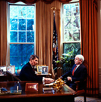 "Undated File photo  (circa 1983)<br /> US President Ronald Reagan (L) discuss with<br /> US Republica Senator John Sidney McCain III  (R) <br /> <br /> <br /> <br /> John Sidney McCain III (born August 29, 1936) is the senior United States Senator from Arizona and presumptive Republican Party nominee for President of the United States in the 2008 election.<br /> <br /> McCain graduated from the United States Naval Academy in 1958 and became a naval aviator, flying ground-attack aircraft from aircraft carriers. During the Vietnam War, he nearly lost his life in the 1967 USS Forrestal fire. Later that year while on a bombing mission over North Vietnam, he was shot down, badly injured, and captured as a prisoner of war by the North Vietnamese. He was held from 1967 to 1973, experiencing episodes of torture and refusing an out-of-sequence early repatriation offer; his war wounds would leave him with lifelong physical limitations.<br /> <br /> He retired from the Navy as a captain in 1981 and, moving to Arizona, entered politics. He was elected to the U.S. House of Representatives in 1982. After serving two terms, he was elected to the U.S. Senate in 1986, winning re-election easily in 1992, 1998, and 2004. While generally adhering to conservative principles, McCain has gained a media reputation as a ""maverick"" for disagreeing with his party on several key issues. After being investigated in a political influence scandal of the 1980s, as a member of the ""Keating Five"", he made campaign finance reform one of his signature concerns, which eventually led to the passage of the McCain-Feingold Act in 2002. He is also known for his work towards restoring diplomatic relations with Vietnam in the 1990s, and for his belief that the war in Iraq should be fought to a successful conclusion in the 2000s. McCain has chaired the powerful Senate Commerce Committee, and has been a leader in seeking to rein in both pork barrel spending as well as Senate filibusters of judicial nominations.<br /> <br /> McCain lost the Republican nomination in the 2000 preside"