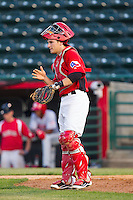 Hickory Crawdads catcher Kellin Deglan (6) goes through defensive signs during the game against the Hagerstown Suns at L.P. Frans Stadium on May 7, 2014 in Hickory, North Carolina.  The Suns defeated the Crawdads 4-2.  (Brian Westerholt/Four Seam Images)