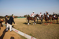 Australia's High Commissioner to India Dr Lachlan Strahan (2nd from left) tosses the first ball to the players to start the game between the Royal Jaipur Polo Team (in pink) and the Western Australia Polo Team (in black) for the Argyle Pink Diamond Cup, organised as part of the 2013 Oz Fest in the Rajasthan Polo Club grounds in Jaipur, Rajasthan, India on 10th January 2013. Photo by Suzanne Lee