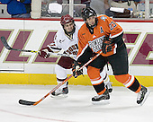 Pat Gannon 13 of Boston College and Brandon Svendsen 23 of Bowling Green look to receive the puck.  The Eagles of Boston College defeated the Falcons of Bowling Green State University 5-1 on Saturday, October 21, 2006, at Kelley Rink of Conte Forum in Chestnut Hill, Massachusetts.<br />