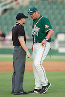 Greensboro Grasshoppers pitching coach Jeremy Powell (55) argues with umpire Robert Waterhouse after being ejected for disputing a call during the game against the Kannapolis Intimidators at CMC-NorthEast Stadium on August 31, 2014 in Kannapolis, North Carolina.  The Grasshoppers defeated the Intimidators 3-1.  (Brian Westerholt/Four Seam Images)