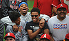 Dominic Smith of the New York Mets has fun with Amityville baseball players during their visit to Citi Field in Flushing, NY on Saturday, June 23, 2018.