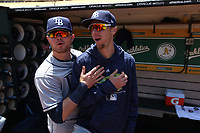 OAKLAND, CA - MAY 31:  Christian Arroyo #21 and Matt Duffy #5 of the Tampa Bay Rays get ready in the dugout before the game against the Oakland Athletics at the Oakland Coliseum on Thursday, May 31, 2018 in Oakland, California. (Photo by Brad Mangin)