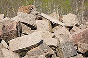 Large blocks of pink granite at the abandoned Redstone Granite quarry in Conway, New Hampshire. The green and pink granite harvested from the Redstone Quarry can still be found in buildings and monuments throughout New England and beyond.