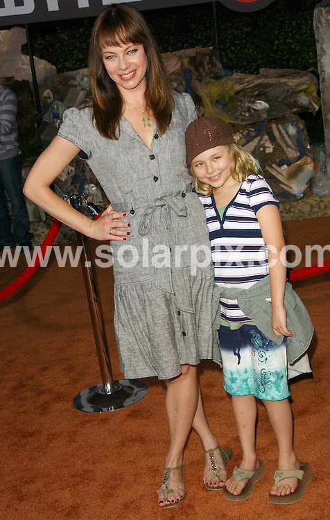 **ALL ROUND PICTURES FROM SOLARPIX.COM**.**SYNDICATION RIGHTS FOR UK, SPAIN, PORTUGAL, AUSTRALIA, S.AFRICA & DUBAI (U.A.E) ONLY**.The  film WALL.E World Premiere at the Greek Theatre in Los Angeles, California in the USA.  .This pic:Melinda Clarke with daughter Catherine..JOB REF:6708-PHZ/Albert L. Ortega    DATE:21_06_08 .**MUST CREDIT SOLARPIX.COM OR DOUBLE FEE WILL BE CHARGED* *UNDER NO CIRCUMSTANCES IS THIS IMAGE TO BE REPRODUCED FOR ANY ONLINE EDITION WITHOUT PRIOR PERMISSION*
