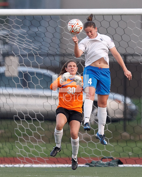 Boston Breakers defender Cat Whitehill (4) heads out a shot on net. In a Women's Premier Soccer League Elite (WPSL) match, the Boston Breakers defeated New England Mutiny, 4-2, at Dilboy Stadium on June 20, 2012.