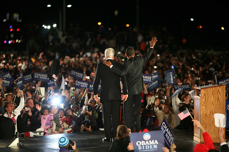 U.S. Democratic Presidential nominee Sen. Barack Obama (D-IL) takes the stage with former President Bill Clinton at a campaign rally in Kissimmee, Florida, October 29, 2008.