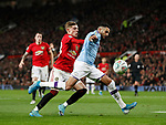 Riyad Marhez of Manchester City gets behind Brandon Williams of Manchester United during the Carabao Cup match at Old Trafford, Manchester. Picture date: 7th January 2020. Picture credit should read: Darren Staples/Sportimage