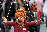 "Manifestazione ""No Monti Day"" contro le politiche economiche e sociali del governo, a Roma, 27 ottobre 2012..Puppets of German Chancellor Angela Merkel and Italian Premier Mario Monti, right, are seen during the ""No Monti Day"" demonstration against government's  financial cuts, in Rome, 27 October 2012..UPDATE IMAGES PRESS/Riccardo De Luca"