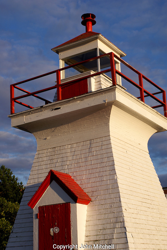 Red and white wooden lighthouse in the city of Saint John, New Brunswick, Canada