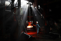 Workers operate on the old assembly line that was built in the 1960s to make train carriage wheels at Ma Steel in Maanshan, China. With an additional plant that opened last year, Ma Steel is the world's largest producer of train carriage wheels with an annual capacity of 1.1 million units..29 Dec 2008..
