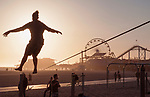Tight rope practice on beach near the Santa Monica Pier, Los Angeles, CA