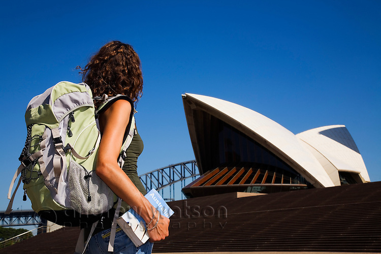 A backpacker at the Sydney Opera House.  Sydney, New South Wales, AUSTRALIA.