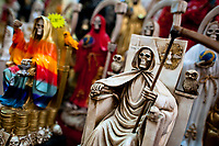Figurines of Santa Muerte (Saint Death) are seen for sale in a witchcraft market in the center of Mexico City, Mexico, 27 April 2011. The religious cult of Santa Muerte is a syncretic fusion of Aztec death worship rituals and Catholic beliefs. Born in lower-class neighborhoods of Mexico City, it has always been closely associated with crime. In the past decades, original Santa Muerte's followers (such as prostitutes, pickpockets and street drug traffickers) have merged with thousands of ordinary Mexican Catholics. The Saint Death veneration, offering a spiritual way out of hardship in the modern society, has rapidly expanded. Although the Catholic Church considers the Santa Muerte's followers as devil worshippers, on the first day of every month, crowds of believers in Saint Death fill the streets of Tepito. Holding skeletal figurines of Holy Death clothed in a long robe, they pray for power healing, protection and favors and make petitions to 'La Santísima Muerte', who reputedly can make life-saving miracles.