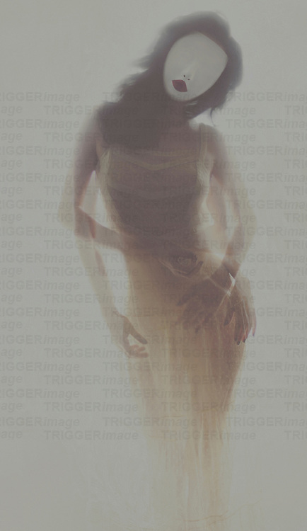 Conceptual image of young woman with long dark hair head to one side wearing white face mask and long yellow dress with montaged arms