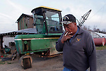 Tobacco farmer John Ashe, 44, smokes a cigarette before working on his Reidsville, NC, farm on Friday, Feb. 24, 2012.  North Carolina tobacco farmers fear they could lose much of their export business because the health industry wants to exclude tobacco products from a major trade agreement with eight Pacific Rim countries.   Photo by Ted Richardson