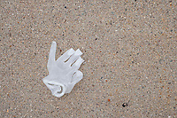 A discarded latex glove is seen on a sidewalk in Belmont, Massachusetts, on Mon., April 20, 2020. During the ongoing Coronavirus (COVID-19) global pandemic Personal Protective Equipment such as latex gloves has become a common sight among litter in the streets.
