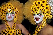 Rio de Janeiro, Brazil. Two transvestites dressed in mini sunflowers; Carnival.