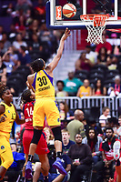 Washington, DC - August 17, 2018: Los Angeles Sparks forward Nneka Ogwumike (30) hits a hook shot over Washington Mystics guard Tierra Ruffin-Pratt (14) during game between the Washington Mystics and Los Angeles Sparks at the Capital One Arena in Washington, DC. (Photo by Phil Peters/Media Images International)