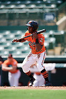 Baltimore Orioles Kirvin Moesquit (52) pulls back a bunt attempt during an Instructional League game against the Atlanta Braves on September 25, 2017 at Ed Smith Stadium in Sarasota, Florida.  (Mike Janes/Four Seam Images)