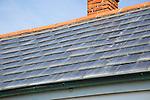 Photovoltaic roof tiles on building, Kynance Cove, Lizard Peninsula, Cornwall, England, UK
