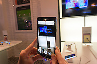 A visitor uses the camera on the new Samsung Galaxy Note 4, in a Samsung pop-up shop in Soho in New York on the phablet's release date, Friday, October 17, 2014. Samsung released the new Galaxy Note 4 today going head to head with the Apple iPhone 6 Plus in what is being called the phablet wars. (© Richard B. Levine)