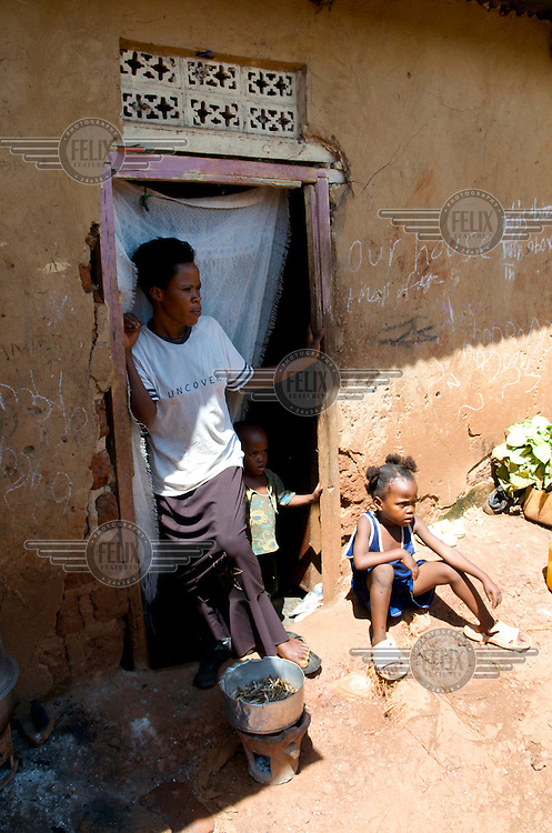 Families squatting in settlements outside Kampala. They do not own the land they live on and are at constant risk of eviction.