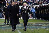 United States President Barack Obama walks with Lieutenant General David Huntoon, Superintendent of the U.S. Military Academy, right, after crossing the field during the 112th Army-Navy Football game at FedEx Field in Landover, Maryland on Saturday, December 10, 2011. .Credit: Kristoffer Tripplaar  / Pool via CNP