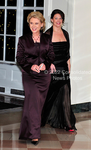 Governor Christine Gregoire of the State of Washington, left, and Courtney Gregoire, right, arrive for the State Dinner in honor of President Hu Jintao of China at the White House In Washington, D.C. on Wednesday, January 19, 2011. .Credit: Ron Sachs / CNP