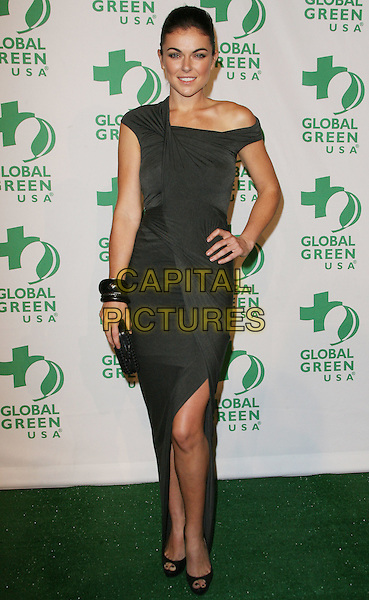 Serinda Swan.Global Green USA's 9th Annual Pre-Oscar Party held at the Avalon, Hollywood, California, USA..February 22nd, 2012.full length  grey gray off the shoulder dress bracelets slit split clutch bag hand on hip.CAP/ADM.©AdMedia/Capital Pictures.
