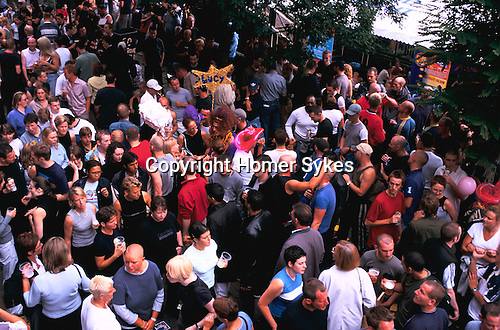 'GAYFEST MANCHESTER, UK', GAY FEST REVELLERS GATHER ON CANAL STREET, DRINKING AND SOCIALISING BEFORE THE PARADE STARTS, 1999