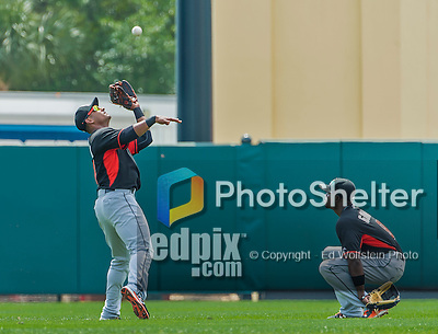 19 March 2015: Miami Marlins infielder Donovan Solano pulls in a fly ball during Spring Training action against the Atlanta Braves at Champion Stadium in the ESPN Wide World of Sports Complex in Kissimmee, Florida. The Braves defeated the Marlins 6-3 in Grapefruit League play. Mandatory Credit: Ed Wolfstein Photo *** RAW (NEF) Image File Available ***