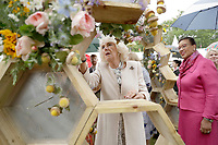 12 June 2019 - Scotland, UK - Camilla Duchess of Cornwall with Patricia Scotland, Baroness Scotland of Asthal, the Secretary General of the Commonwealth places a bee made out of Craspedia flowers, birch wood slices and leaves on the McQueens Flower School stand as she attends the Bees for Development biennial Bee Garden Party at Marlborough House. Photo Credit: ALPR/AdMedia