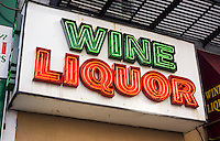 "A liquor store displays their ""Wine Liquor"" neon sign in the Chelsea neighborhood of New York on Friday, April 17, 2015. (© Richard B. Levine)"