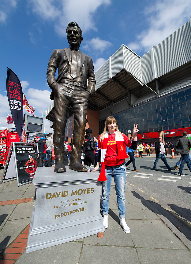Liverpool fans pose next to a statue of David Moyes inscribed with the legend - David Moyes For Services to Liverpool Football Club<br /> <br /> Photo by Stephen White/CameraSport<br /> <br /> Football - Barclays Premiership - Liverpool v Chelsea - Sunday 27th April 2014 - Anfield - Liverpool<br /> <br /> &copy; CameraSport - 43 Linden Ave. Countesthorpe. Leicester. England. LE8 5PG - Tel: +44 (0) 116 277 4147 - admin@camerasport.com - www.camerasport.com