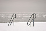 Middle Beach Road. Madison Beach railings to beach in snow. Long Island Sound.