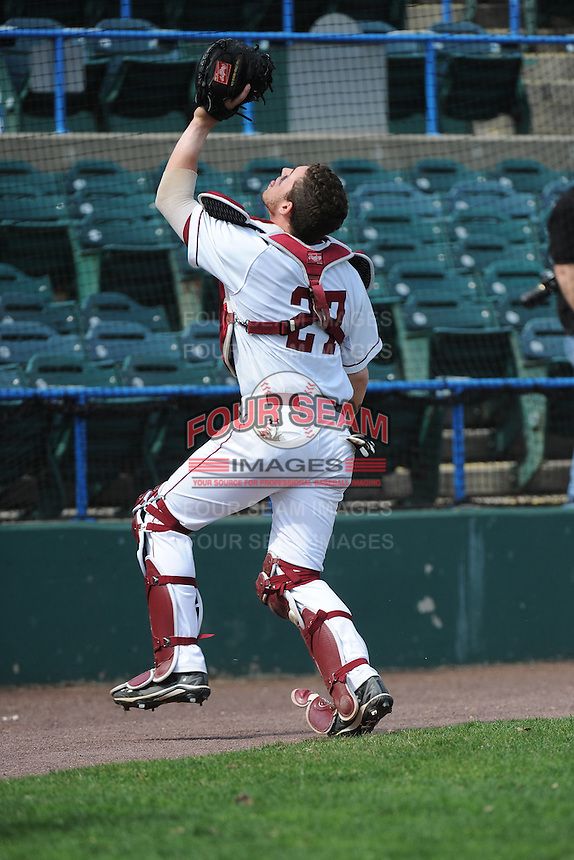Temple University Owls catcher Michael D'Acunti (27) during warmups before a game against the University of South Florida Bulls at Campbell's Field on April 13, 2014 in Camden, New Jersey. USF defeated Temple 6-3.  (Tomasso DeRosa/ Four Seam Images)