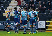 Adebayo Akinfenwa of Wycombe Wanderers celebrations his goal with a new routine with teammates during the Sky Bet League 2 match between Notts County and Wycombe Wanderers at Meadow Lane, Nottingham, England on 10 December 2016. Photo by Andy Rowland.
