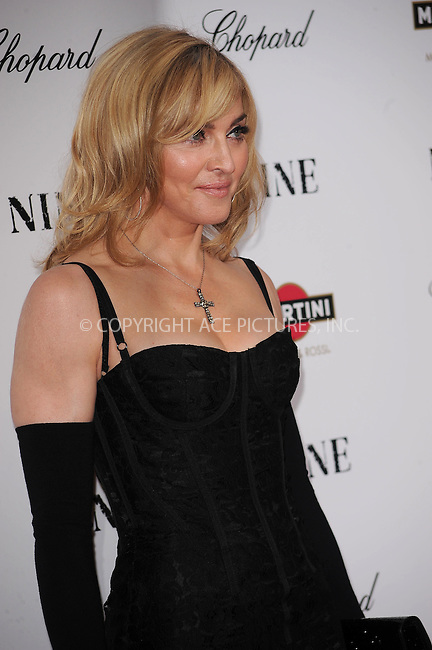 WWW.ACEPIXS.COM . . . . . ....December 15 2009,  New York City....Singer Madonna arriving at the New York premiere of 'Nine' at the Ziegfeld Theatre on December 15 2009 in New York City....Please byline: KRISTIN CALLAHAN - ACEPIXS.COM.. . . . . . ..Ace Pictures, Inc:  ..(212) 243-8787 or (646) 679 0430..e-mail: picturedesk@acepixs.com..web: http://www.acepixs.com