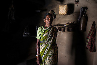 Meena Mahato, 60 years old, and her husband Shyanti Mahato, 67, live in the village of Bhaluk Pahari. 13 years ago, Meena was accused of being a witch after her son died. Despite a visit to the holy sanctuary of Goya (portrayed in the picture the couple hold in their hands) Meena and Shyanti were badly beaten, forced to leave their house and relocate at the edge of the village. Today, they are hosted by Shushen Mahato. The couple is barred from visiting the temple, the market or any social gathering within the village.