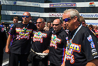 Jun 6, 2015; Englishtown, NJ, USA; NHRA pro mod driver Mike Castellana (center) and crew members from multiple teams during a moment of silence for a crew member during qualifying for the Summernationals at Old Bridge Township Raceway Park. Mandatory Credit: Mark J. Rebilas-
