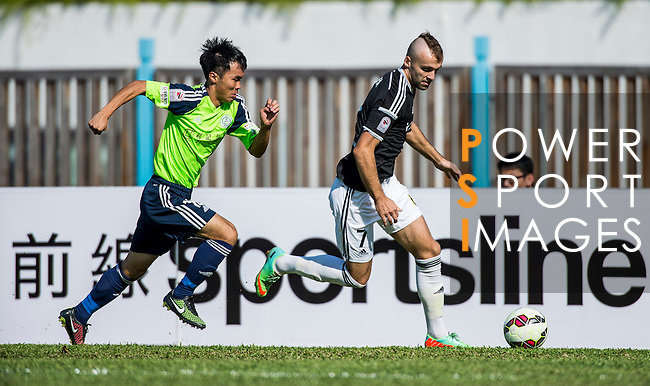 Petrisor Voinea of Sun Pegasus FC (R) followed by Ngai Tong Lam of Wofoo Tai Po  (L) during the HKFA Premier League between Wofoo Tai Po vs Sun Pegasus at the Tai Po Sports Ground on 22 November 2014 in Hong Kong, China. Photo by Aitor Alcalde / Power Sport Images