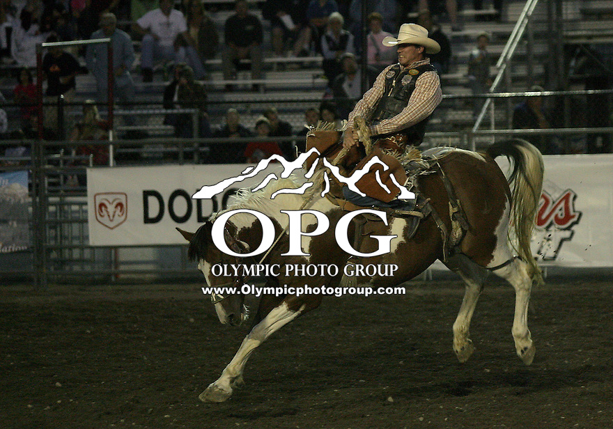 """28 Aug 2010:   Justin Berg scored a 75 in the SaddleBronc riding  competition at the Kitsap County Stampede Wrangle Million Dollar PRCA Silver Rodeo Tour Bremerton, Washington. Saturday night was """"TUFF ENOUGH TO WEAR PINK"""" for support of Breast Cancer awareness."""